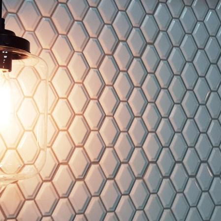 Soho White Convex Loft installed as a backsplash with Edison light illuminating