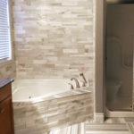 Bianco Cobalt Cubic Ledgestone and Equator Marble Tile installed