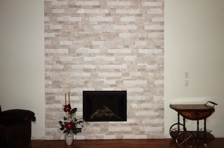 Impero Reale splitface installed on a fireplace