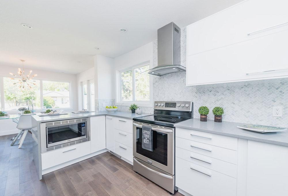 Bianco Carrara Herringbone installed as a kitchen backsplash