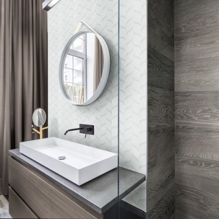 Element Ice Petal Glass Tile Mosaic installed in a bathroom backsplash