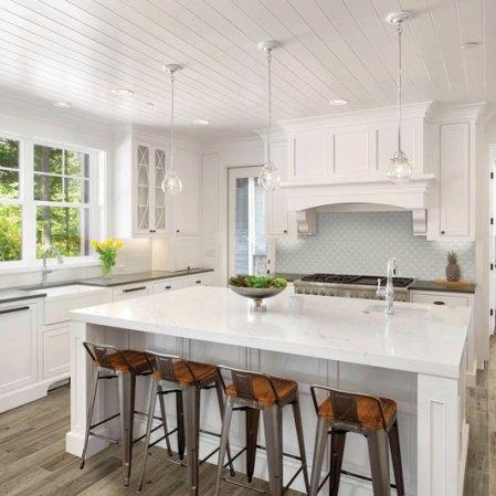 Element Mist scallop backsplash installed in a white kitchen
