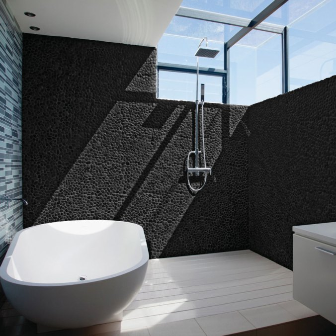 River Midnight Pebbles Round installed on a shower wall