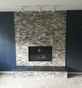 Silver Travertine Splitface Ledgestone fireplace install