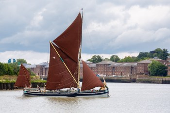 Thames barge sailing off Chatham Dockyard