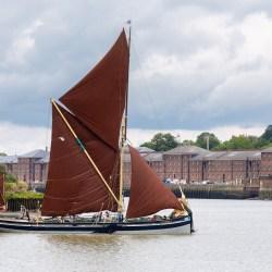 Thames barge sailing off Chatham Dockyard