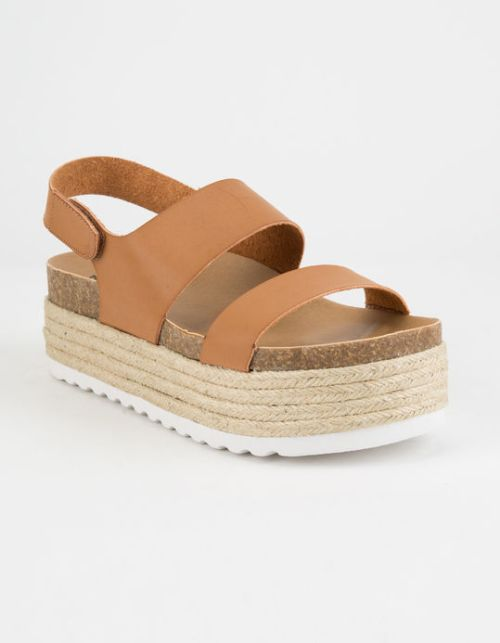 The Dirty Laundry Peyton Espadrille Flatform Sandal features a rope wrapped platform heel and a velcro ankle strap.