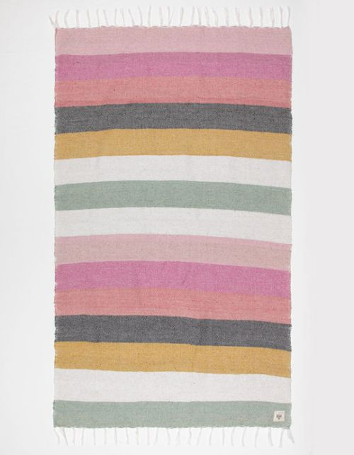 Billabong Sunkissed Dreams Beach Blanket is a striped beach blanket made from recycled yarn and features a fringe trim detail. A perfect summer essential for beach days!