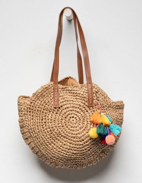 Orchid Love Pom & Tassel straw bag features decorative and colorful tassels and faux leather shoulder straps.
