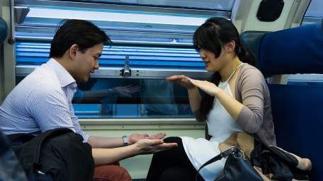 Steven and Cathy playing those clapping games on the train.
