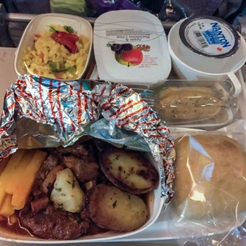 Dinner on Emirates. Lamb, potatoes, and some type of pasta.