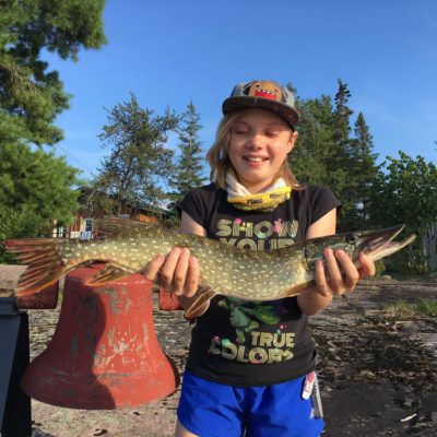 girl holding pike at the toque
