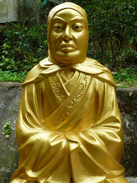 Stern Looking Buddha with Full Cloak