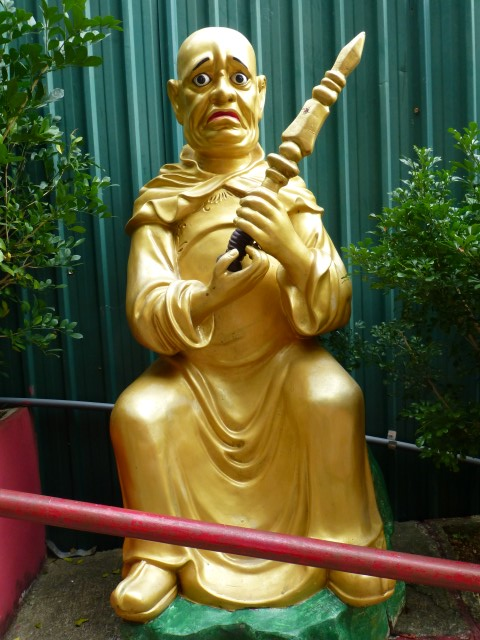 Sad Buddha with scepter.