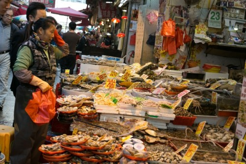 This woman has worked a long day in the market.  Look at all those choices.