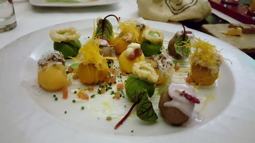 Causa with various toppings from sauces to fish to edible flowers.