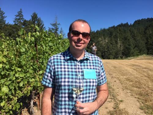 Enjoying some Pinot Gris in the vineyard