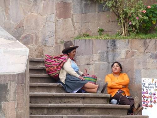 Two women relaxing on the steps. I love a fancy hat.