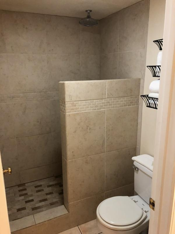 No door or curtain on this shower