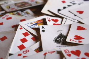 A scattered pile of playing cards.