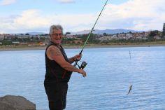 Toni Thomas from Christchurch hooks a wee dog fish.