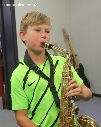 George Lister enjoys a chance to play the sax.