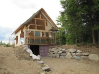 Cabin Living Magazine features TimberHomes Off