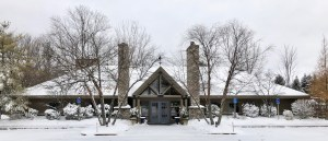 The exterior of Timbers Inn Restaurant & Tavern covered in snow.