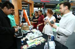 Members of the public at Social Entrepreneurs, Recovr Initiative's booth, getting to know a little more about the recycling process and products