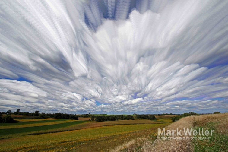 Timestack photography of clouds over farmland