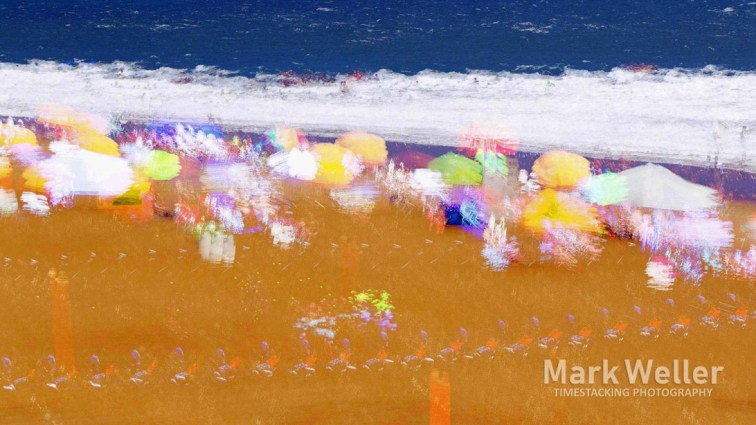 Timestack photography of abstract sand umbrellas ocean waves