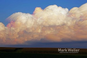 Timestack photography of clouds over field