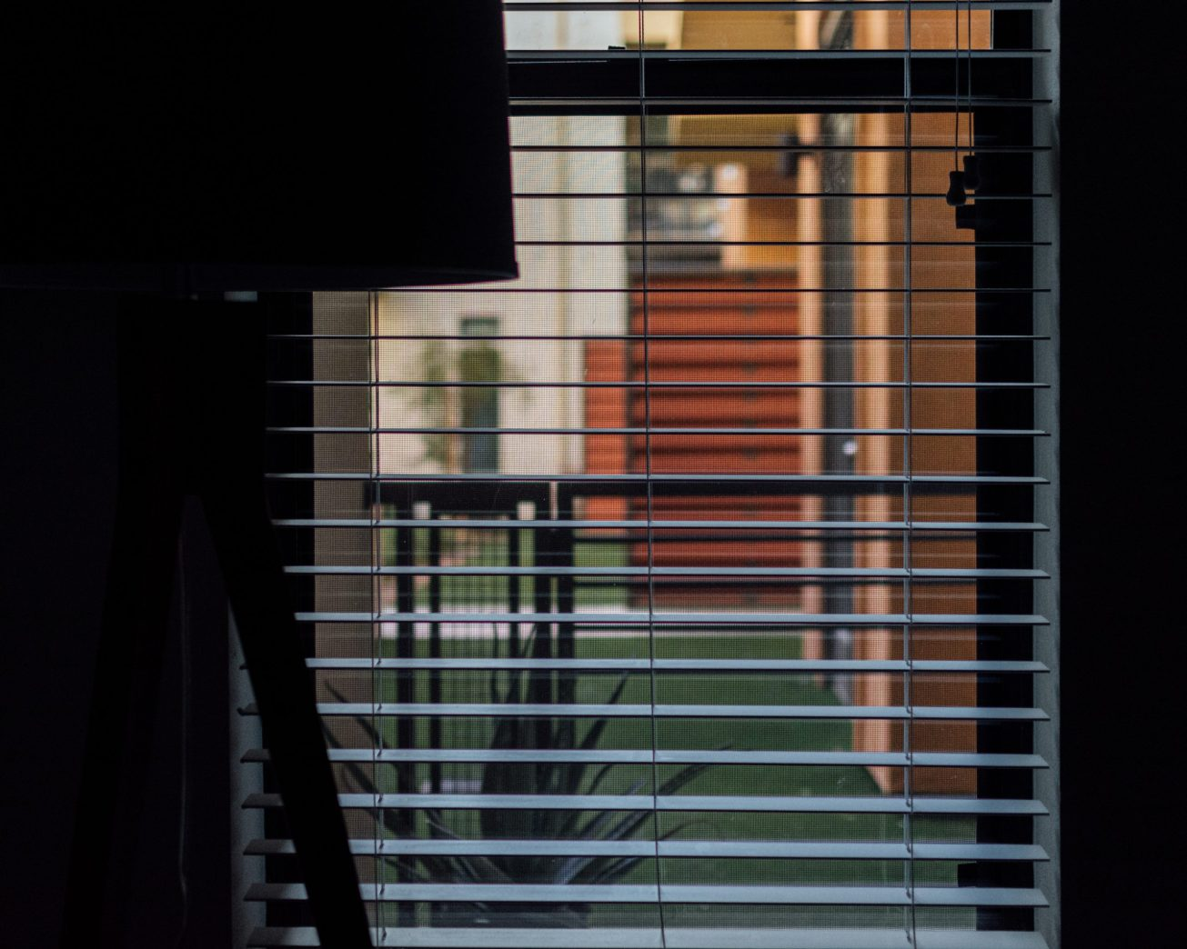 Photos of a silhouetted lamp against a window covered in blinds.