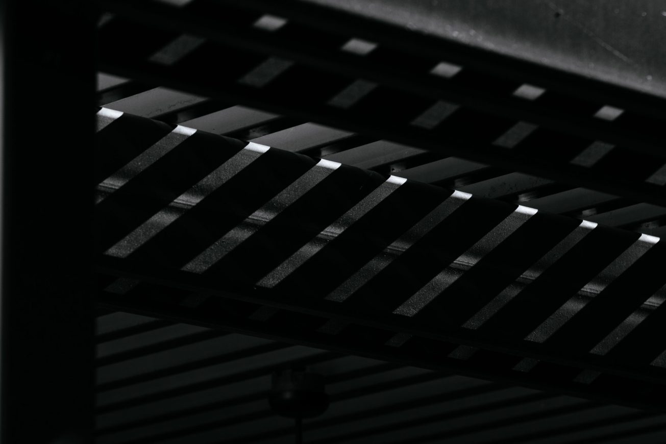 Black and white photo of a high contrast pattern of light and shadow.