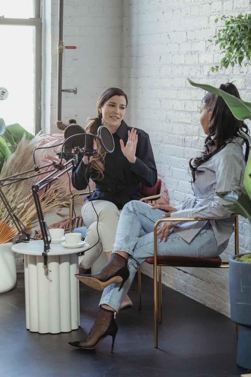 woman talking to black female guest in studio