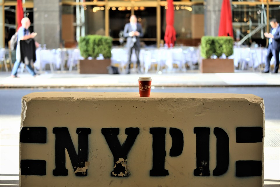 Partners coffee mug on NYPD barrier in New York City, USA