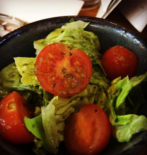 salad leaves and tomatoes with a lemon and basil dressing
