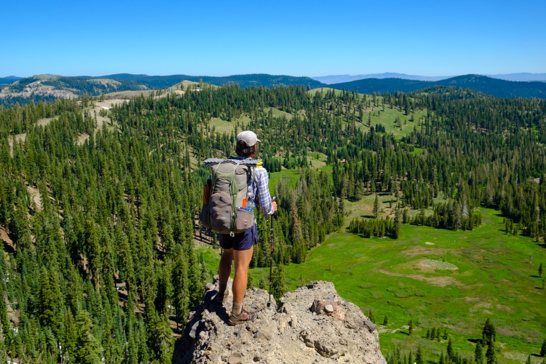 Backpacker looking out over the forests of Northern California