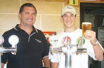 Mick and son, Peter Hanley at the bar of the Cabbage Tree Hotel, Fairy Meadow in 2003
