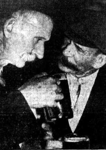 """GONE ARE THE DAYS - """"I remember the time when a pint cost only 3d,"""".says Jack Watchirs to his old friend of 40 years coal-mining, Frank Reeves, as they take theirFix this text drink at the Bulli Family Hotel, in the centre of the beer strike zone. Photo: Queensland Times (Ipswich, Qld) January 11 1941."""