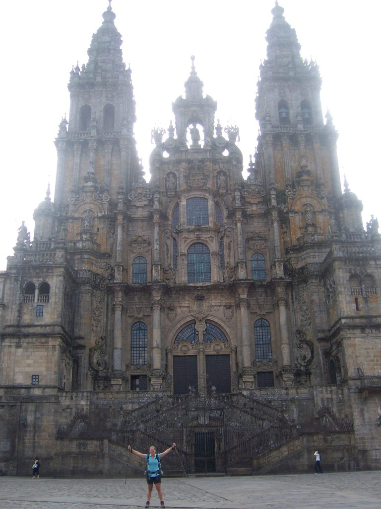 A pilgrim in front of the cathedral at Santiago de Compostela