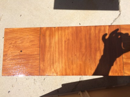 The color reached after four coats of stain.