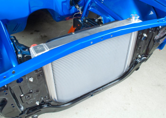 If your car runs hot all the time, not just at idle, your problem is most likely an insufficient or failing radiator. Radiators deteriorate over time, but most of the time we make performance improvements to the engine to make more power and forget that more power means more heat.