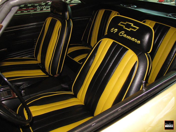 This is what we started with, an out-of-date, not even matching ugly mess. The car's exterior color is Butternut Yellow, and the interior cover yellow is closer to Daytona Yellow. We can't imagine this looked good even when it was new 20-25 years ago.