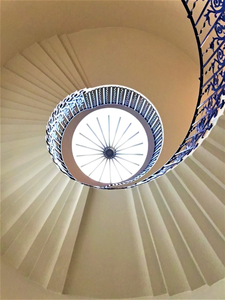 The elegant, uniquely designed spiral staircase at the Queen's House.