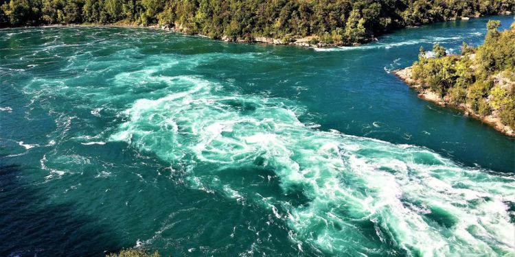 The Whirlpool forms at the end of the rapids, where the gorge turns abruptly counter-clockwise to the northeast.