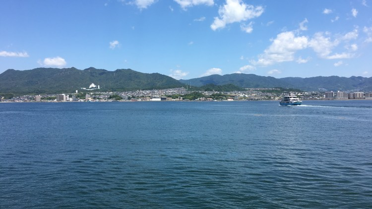 The ferry ride along Hiroshima Bay to Miyajima Island.