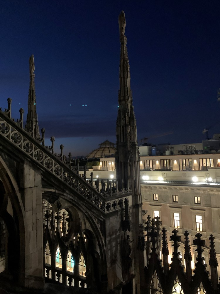 The Best of Milan – Sunset on the rooftop of the Duomo  Star-like lights in the distance on this clear blue skies