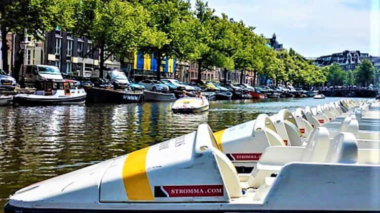 Amsterdam.responsible tourism.pedal boats | Canal biking in Amsterdam | responsible tourism in Amsterdam