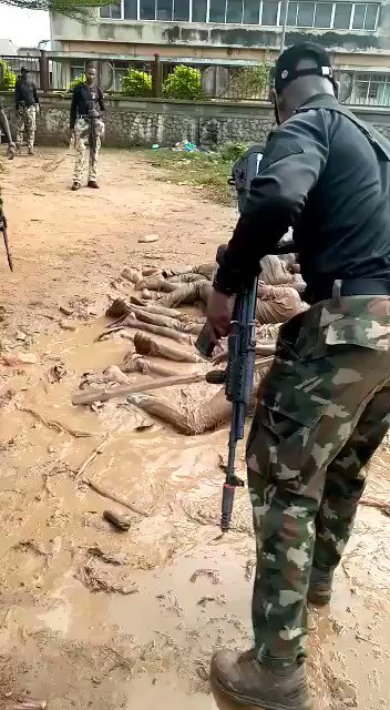 Soldier flogging and forcing civilians to swim in mud water